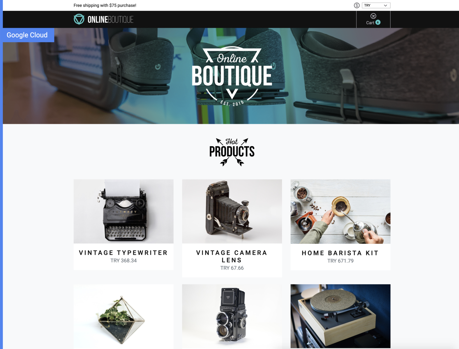 Online Boutique home page showing pictures of various products such as bikes, cameras, typewriters, and so on.