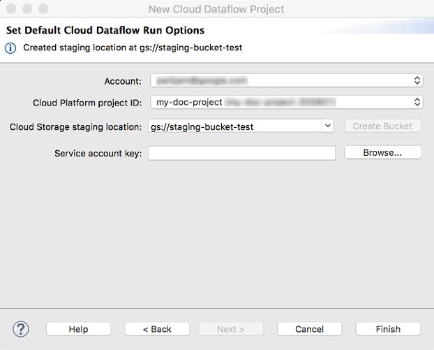 Un diálogo para ingresar la cuenta de GCP, el ID de CloudPlatform y la ubicación de etapa de pruebas de CloudStorage. El botón Crear te permite crear una nueva ubicación de etapa de pruebas. Los botones sirven para retroceder, avanzar a la siguiente ventana, cancelar la operación o finalizarla.