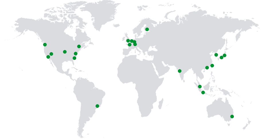 World map with green dots depicting regional centers and global coverage.
