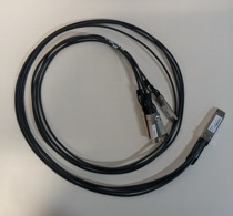 A photo depicting a QSFP+ to 4xSFP+ network cable