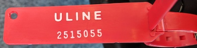 "An image of a tamper-evident tag. The tag is imprinted with two lines: the top line says ""ULINE"", the bottom line is the tag's serial number"